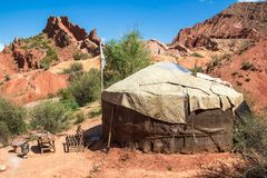 Yurt in. Traditional hous of Nomad people of Kyrgys republic  in red rocks on south of Issyk-Kul lake on the east of Kyrgyzstan Kyrgyz republic. famous touristic Stock Images