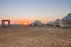 Yurts in the desert at sunset.  Uzbekistan Stock Photo