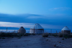 Yurts in the evening on the shore of a mountain lake. Stock Photography