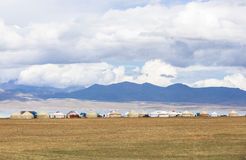 YURTS AT SONG KUL LAKE IN KYRGYZSTAN. This photo was taken on July, 2015 in Songkul lake, Kyrgyzstan. Song Kul is a high alpine lake in the Tian Shan Mountains royalty free stock photo