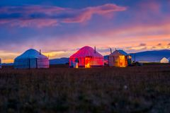 Yurts in twilight, Song Kul. Illuminated yurt in twilight by Song Kul lake, Kyrgyzstan Stock Image
