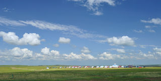 Yurts under blue sky and white clouds Royalty Free Stock Image