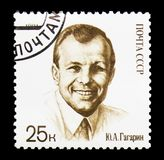 Yury Gagarin in civilian dress, 30th Anniversary of First Man in. MOSCOW, RUSSIA - MARCH 31, 2018: A stamp printed in USSR (Russia) shows  Yury Gagarin in Stock Photos