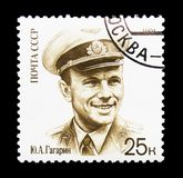 Yury Gagarin in uniform with cap, 30th Anniversary of First Man. MOSCOW, RUSSIA - MARCH 31, 2018: A stamp printed in USSR (Russia) shows  Yury Gagarin in uniform Stock Images