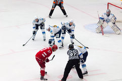 Yury Koksharov (27) on faceoff. MOSCOW - OCTOBER 17, 2015: Yury Koksharov (27) on faceoff during hockey game Vityaz vs Barys on Russia KHL championship on Royalty Free Stock Photo