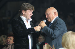 Yury Luzhkov sing with singer from North Osetia. The mayor of Moscow, Yury Luzhkov sing in the Russia hall in the Luzhniki, Moscow with honoured artist of North Royalty Free Stock Photos