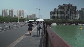 Yuya Rd, Bridge over the Sanya River in Sanya City on Hainan Island stock footage video. Sanya, China - April 02, 2017: Yuya Rd, Bridge over the Sanya River in stock footage