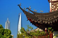 Yuyuan Garden in Shanghai. Pudong skyscrapers seen from the Yu Garden pavilion, Shanghai, China Stock Photography