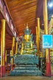The golden statues in Buddhist Monastery, Inle Lake, Myanmar. YWAMA, MYANMAR - FEBRUARY 18, 2018: The golden image of Buddha, decorated with inlays and fine Stock Photos