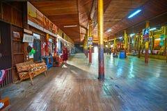 Large hall of Nga Phe Chaung Monastery, Inle Lake, Myanmar. YWAMA, MYANMAR - FEBRUARY 18, 2018: The large wooden hall with golden pillars of Nga Phe Chaung Royalty Free Stock Photos
