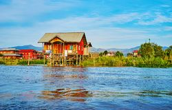 The post office in stilt house, Inle Lake, Myanmar. YWAMA, MYANMAR - FEBRUARY 18, 2018: The small wooden house on stilts in waters of Inle Lake serves as the Royalty Free Stock Images