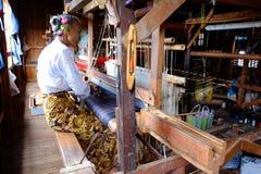 Ywama, Myanmar - 4 July, 2015: Woman works on vintage weaving ma Stock Image