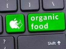 Żywność organiczna na klawiaturowym guziku Zdjęcia Royalty Free