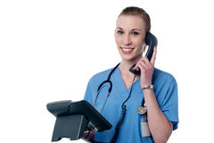 Yyoung female doctor on phone Stock Images