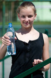 Yyoung woman drinking water after exercise Royalty Free Stock Photo
