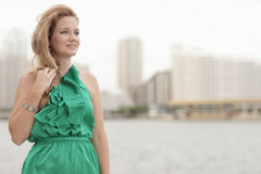 YYoung woman in a green dress by the bay Royalty Free Stock Photos