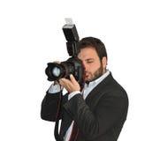 Yyoungs-Fotograf macht Fotos mit der Kamera und dem Blitz Lizenzfreie Stockfotos