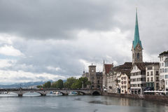 Zürich cityscape with Limmat River and Fraumünster Church tower Royalty Free Stock Image