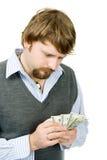 Zählung des Geldes lizenzfreie stockbilder