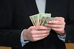Zählung des Geldes Stockbild
