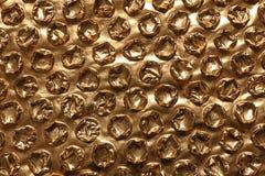 Złoty bąbla opakunek jako tło fotografia stock