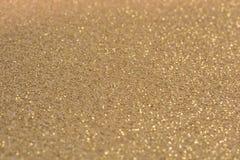 Złoty błyskotliwy tło jako szablon obrazy stock