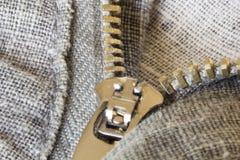 Zíper nas calças cinzentas Imagens de Stock