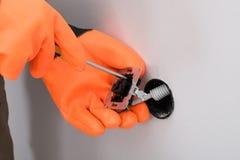 Zócalo de la fijación del electricista en la pared Imagen de archivo libre de regalías