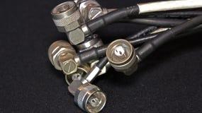 Zócalos y conectores en el cable coaxial Imagen de archivo