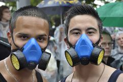 Zürich`s Streetparade: Two asian mens with Gasmasks performing royalty free stock image