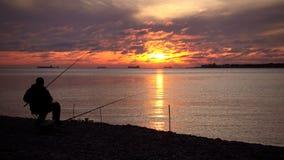 złapany rybi rybak Majestatyczny zmierzch nad wodą zdjęcie wideo