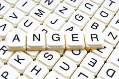 Złość teksta słowa crossword Abecadło list blokuje gemowego tekstury tło Obraz Stock