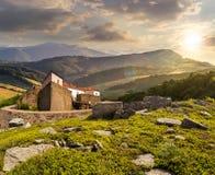 Złożony krajobraz z fortecą w drewnach na halnym zboczu Obrazy Royalty Free