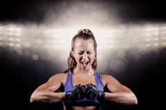 Złożony wizerunek agresywny żeński bokser napina mięśnie Zdjęcie Stock