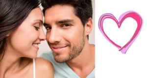 Złożony wizerunek atrakcyjny pary obsiadanie na łóżku Zdjęcia Royalty Free