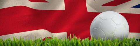 Złożony wizerunek białej skóry futbol z traw plamami royalty ilustracja