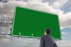 Złożony wizerunek biznesmen pozycja z ręką na biodrze Zdjęcia Stock