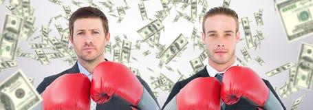 Złożony wizerunek biznesmen z bokserskimi rękawiczkami zdjęcie stock