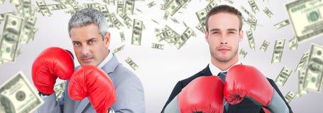 Złożony wizerunek biznesmen z bokserskimi rękawiczkami zdjęcia royalty free