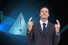 Złożony wizerunek biznesmen z palcami krzyżującymi jest przyglądający up Obraz Stock