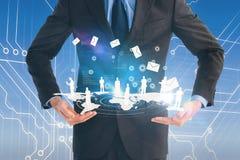 Złożony wizerunek biznesmena mienie coś z jego ręki Fotografia Stock