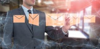 Złożony wizerunek biznesmena writing z markiera niewidzialnym ekranem Fotografia Stock
