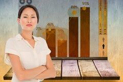 Złożony wizerunek biznesowi koledzy z rękami krzyżował w biurze Zdjęcia Stock