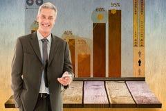 Złożony wizerunek biznesowi koledzy z rękami krzyżował w biurze Fotografia Royalty Free
