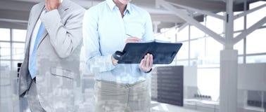 Złożony wizerunek bizneswomanu writing w jej dzienniczku Fotografia Stock