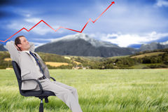 Złożony wizerunek boczny widok oparty w jego krześle biznesmen z powrotem Obrazy Stock