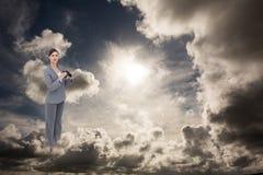 Złożony wizerunek ciekawy młody bizneswoman pozuje z lornetkami Zdjęcie Stock