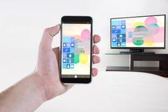 Złożony wizerunek cropped ręki mienia telefon komórkowy Obraz Stock