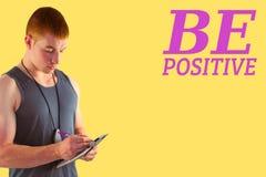Złożony wizerunek dysponowany osobisty trenera writing na schowku Fotografia Stock