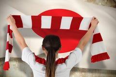 Złożony wizerunek fan piłki nożnej falowania bielu i czerwieni szalik Obrazy Royalty Free